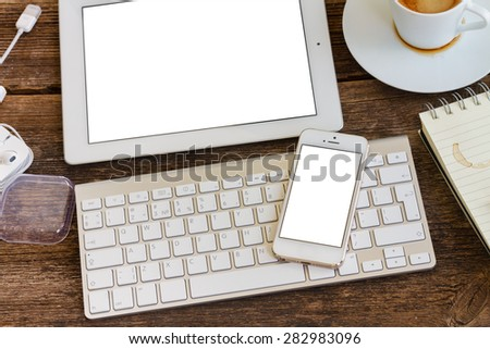 view of  office workplace - phone  on keyboard with tablet, copy space on blank screen - stock photo