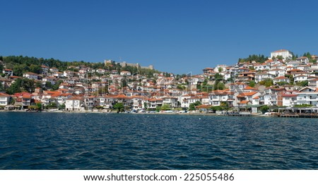 View of Ohrid old town and old fortress from a boat. Lake Ohrid is one of the most famous holiday destinations in the Balcans.  - stock photo