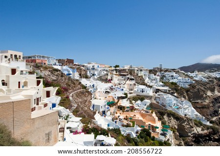 View of Oia with typical houses on the island of Santorini,Greece. - stock photo