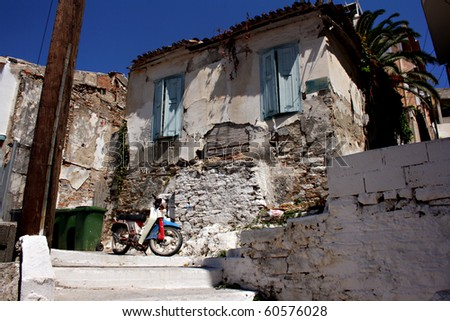View of old crumbling greek house - stock photo