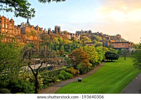View of old Edinburgh, Scotland at sunset from Princes Street Gardens - stock photo