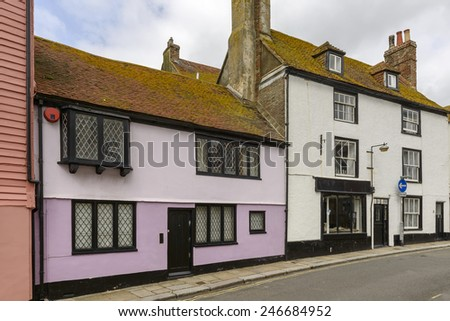 view of old houses on a street in the historic village of Hastings, East Sussex   - stock photo
