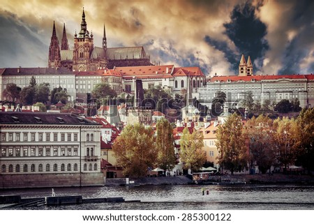 View of old town and Prague castle with river Vltava at sunset - stock photo
