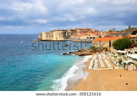 View of old town of Dubrovnik, Croatia over the beaches along the Mediterranean Sea - stock photo