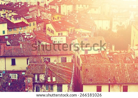 View of old town streets and houses, Lucca, Italy. Color toning effect applied. - stock photo