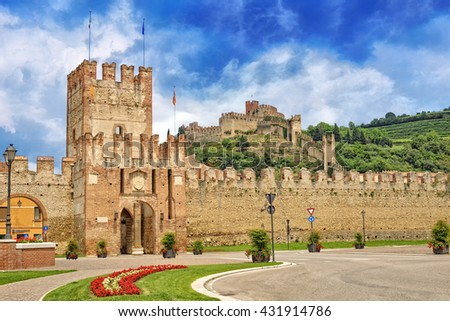 View of old walls and the Scaliger castle. Town of typical wine that bears his name. Soave , Verona Italy - stock photo