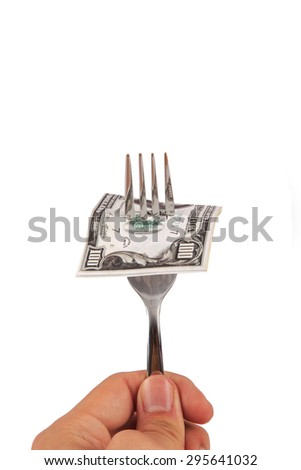 View of one hundred dollar banknotes on a fork, isolated on white background. - stock photo