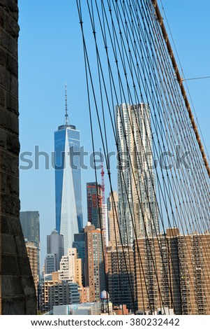 View of One World Trade Center Building Amongst Manhattan Skyscrapers as seen from Brooklyn Bridge, New York City, New York, USA - stock photo
