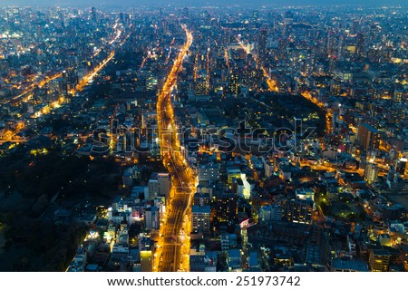View of Osaka at night (all brand names on advertisements blurred) - stock photo
