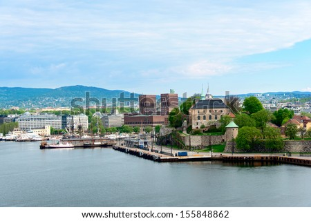 View of Oslo, Norway Radhuset (city hall) and Akershus castle from the sea - stock photo