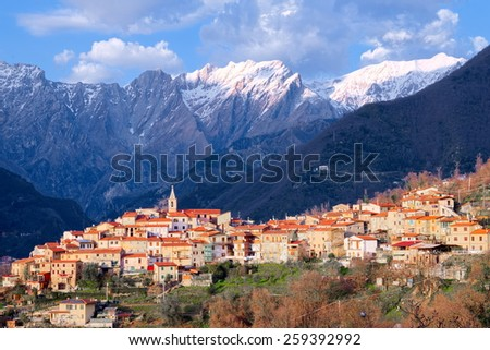 View of Pariana, ancient rural town in the foothills of the Apuan Alps still snowy - stock photo