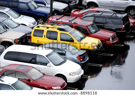 View of parking lot of cars on a rainy day