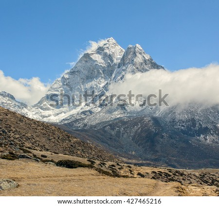 View of peak Ama Dablam (6814 m) from the Mountain ledge above the village of Periche - Everest region, Nepal, Himalayas