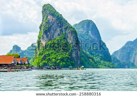 View of Phang Nga bay and the passenger speedboats for tourist in Southern Thailand - stock photo