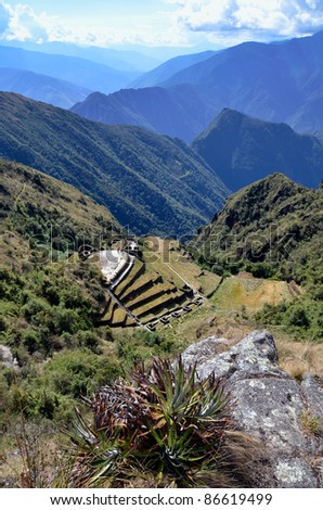 View of Phuyupatamarca ruin on the Inca Trail to the ruins of Machu Picchu with Amazon Jungle and cloudy sky in the background - stock photo