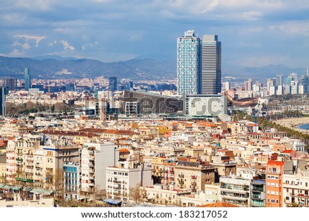 view of picturesque metropolitan area in cloudy day. Barcelona, Spain - stock photo