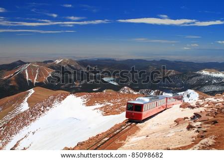 View of Pikes Peak and Manitou Springs Train on the top of Pikes Peak Mountain, Colorado, USA - stock photo