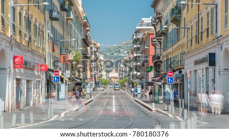 View of Place Garibaldi timelapse with trams on the street and traffic. It is named after Giuseppe Garibaldi, hero of Italian unification (born in Nice). Place Garibaldi is monumental example of