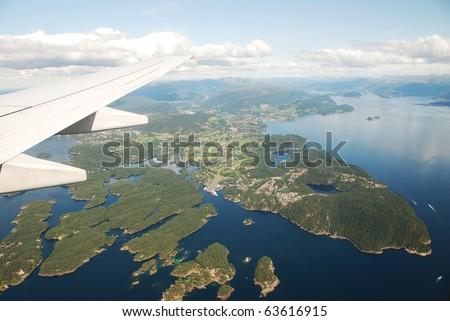View of plane window, fjords, Norway - stock photo