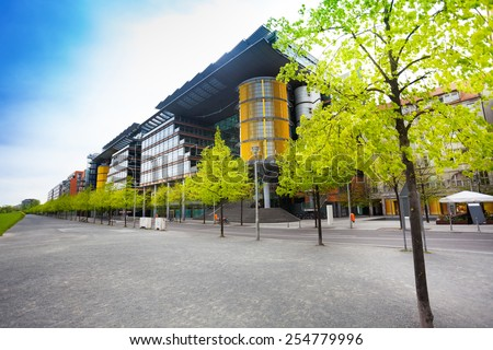 View of Potsdamer Platz with trees row in Berlin, Germany - stock photo