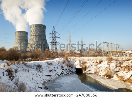 view of power heat station, smoke from the chimney on a frosty winter day - stock photo
