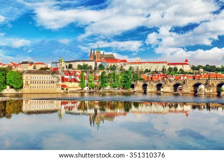 View of Prague Castle and Charles Bridge-famous historic bridge that crosses the Vltava river in Prague, Czech Republic.  - stock photo