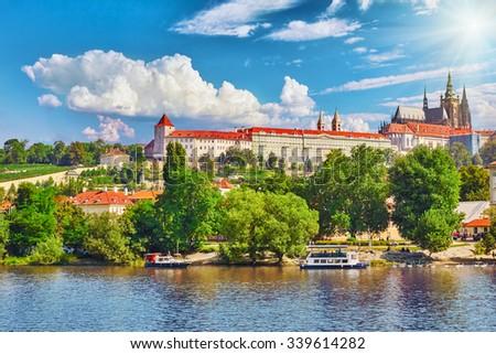 View of Prague Castle from waterfront- famous historic bridge that crosses the Vltava river in Prague, Czech Republic.  - stock photo