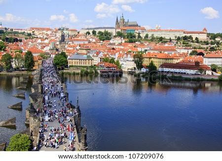 View of Prague, Charles bridge, Vltava river, St. Vitus cathedral - stock photo
