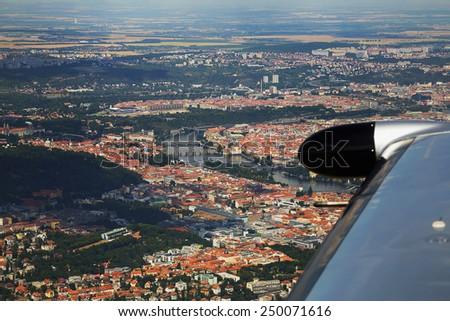 View of Prague city center from airplane landing on a summer day, Prague, Czech Republic - stock photo