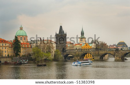 View of Prague with Charles bridge at overcast day