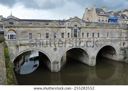 View of Pultney Bridge over the River Avon in Bath England - Designed in the Georgian Palladian Style by Robert Adam the Bridge was Completed in 1774 and is now a Famous Landmark in the Somerset City  - stock photo