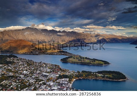 View of Queenstown, Wakatipu Lake and Remarkables Mountains, New Zealand - stock photo