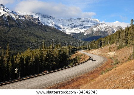 View of quiet highway in morning, kananaskis country, alberta, canada - stock photo