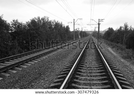 View of rail road tracks. Black and white.