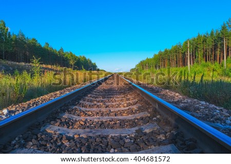 View of railroad track in summer evening - stock photo