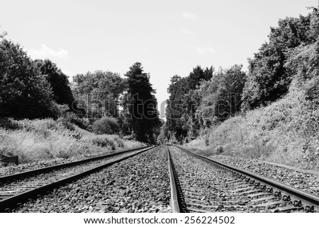 View of Railroad Tracks on a Rural Route in Black and White - stock photo