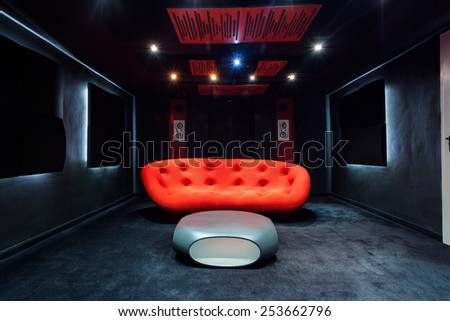 View of red sofa in the basement - stock photo