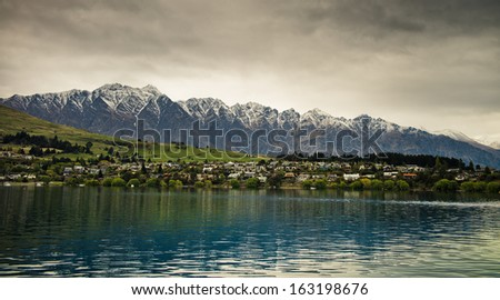 View of Remarkables from Lake Wakatipu, New Zealand - stock photo