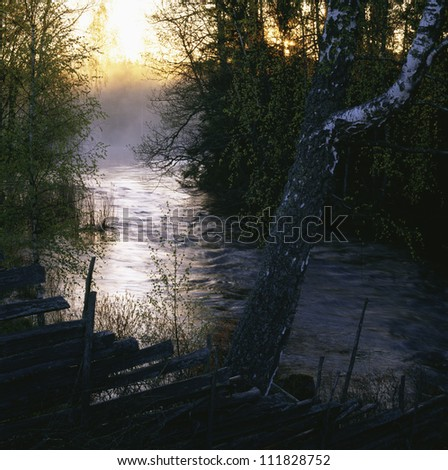 View of river at dusk - stock photo