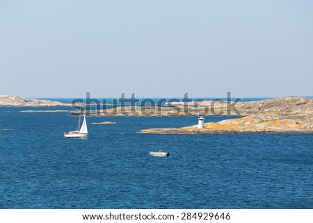 View of rocky archipelago with boats on the Swedish west coast - stock photo