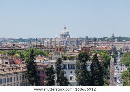 View of Rome from Pincian Hill with St. Peter's Basilica dome in Vatican.