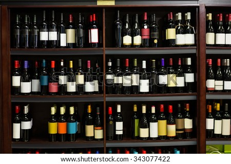 View of row bottles of wine in supermarket - stock photo