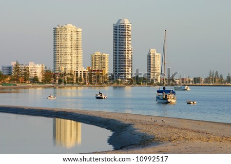 View of Runaway Bay on the Gold Coast in Australia from the Broadwater on a hazy sunrise. - stock photo