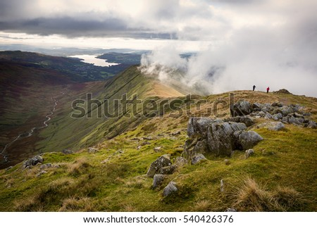 View of Rydal Fell and Lake Windermere from the top of Great Rigg on the Fairfield Horseshoe in Cumbria, UK