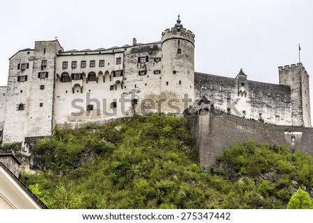 View of Salzburg skyline with Hohensalzburg Castle (Festung Hohensalzburg). Erected at behest of Prince - Archbishops of Salzburg - one of largest medieval castles in Europe. Salzburger Land, Austria. - stock photo