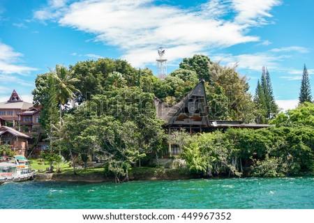 View of Samosir island from water, Toba lake, North Sumatra, Indonesia - stock photo