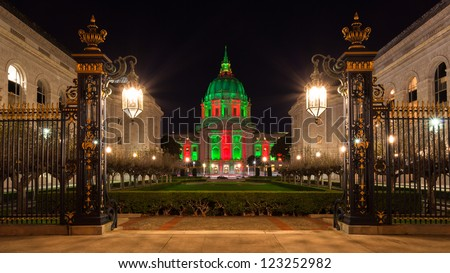 View of San Francisco City Hall in red and green light around Christmas. - stock photo