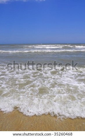 View of sand, surf and sky - stock photo
