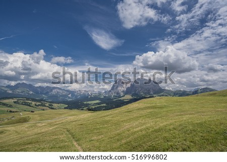 View of Sassolungo & Sassopiatto mountains tower above Alpe di Siusi/Seiser Alm, highest alpine cultivated pasture, as seen from hotel Goldknopf, Dolomites, Trentino, Alto-Adige, South Tyrol, Italy