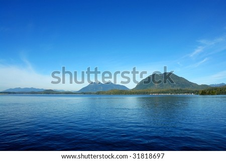 View of sea and mountains in tofino, pacific rim natioinal park, vancouver island, british columbia, canada - stock photo